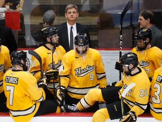 Michigan Tech head coach Mel Pearson, above center,