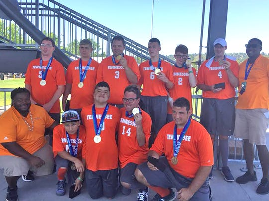 Team Tennessee Flag Football Team displays their gold