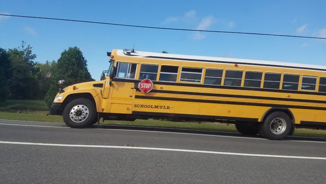 A school bus travels down US Route 9 near Lewes on Oct. 6, 2016.