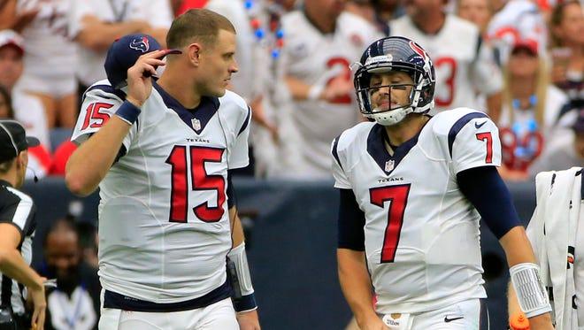 Houston Texans quarterbacks Brian Hoyer, right, and Ryan Mallett react against the Kansas City Chiefs.