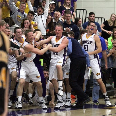 Thomas Kujawski/For Central Wisconsin Sunday The University of Wisconsin Stevens Point's crowd goes wild as the Pointers mob Alex Richard, left center, after his half-court shot goes in the basket to win at the buzzer against Oshkosh Saturday in the Quandt Fieldhouse in Stevens Point.