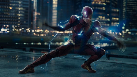 The Flash (Ezra Miller) throws down in fun fashion
