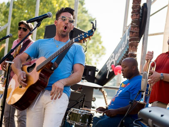Jake Owen performs during a listening party for his new album at Blue Moon Waterfront Grille on July 18, 2016, in Nashville.