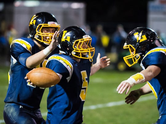Littlestown's Corbin Brown (5) celebrates with teammates