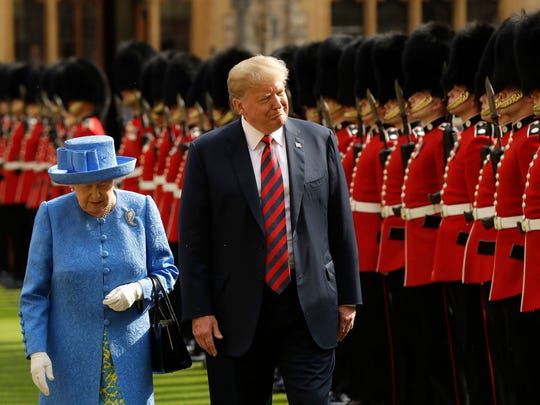 President Donald Trump and Queen Elizabeth II inspect a Guard of Honour formed of the Coldstream Guards at Windsor Castle in July 13, 2018.