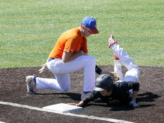 Edison first baseman Adam Houghtling applies the tag