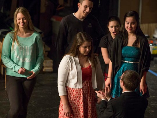 """Senior David Jacobson, who plays Ally, rehearses the proposal scene with Katie Barton, who plays Liz, as the students prepare to present """"Sunshine on Leith"""" at Wilmington Christian School Feb. 27."""