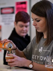 Katie Sands pours a beer sample during a Sippin' Saturday