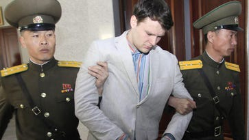 American student Otto Warmbier, center, is escorted at the Supreme Court in Pyongyang, North Korea, on March 16, 2016. North Korea's highest court sentenced Warmbier, a 21-year-old University of Virginia undergraduate student, from Wyoming, Ohio, to 15 years in prison with hard labor for subversion. He allegedly attempted to steal a propaganda banner from a restricted area of his hotel at the request of an acquaintance who wanted to hang it in her church.