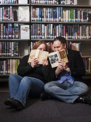 Jamie and Leesha Ford were photographed at the Great Falls Public Library where they first met Wednesday, Dec. 30, 2015. They have been married since 2008.