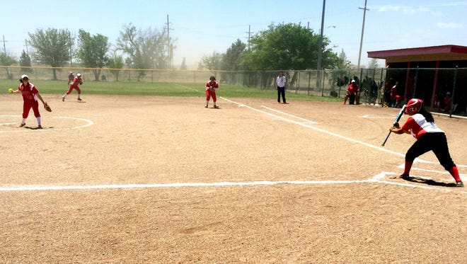 Loving's Autumn McDonald fires a pitch against Eunice's Yvette Mota in the first inning Saturday.