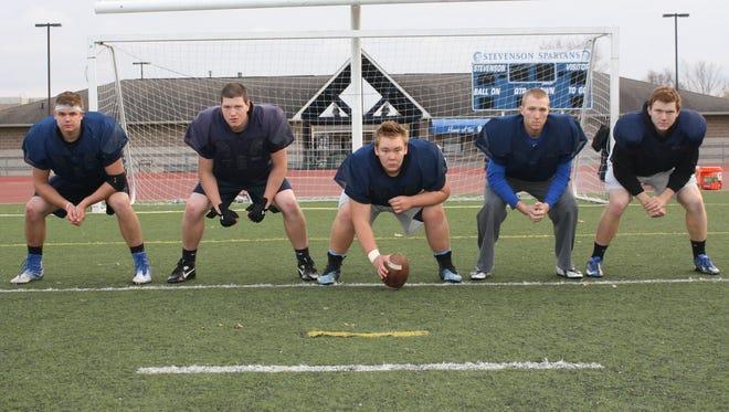 Pictured from left are Livonia Stevenson starting offensive linemen Kyle Foster, Joe Newman, Tyler Demski, Connor McQueen and Brad Scott.