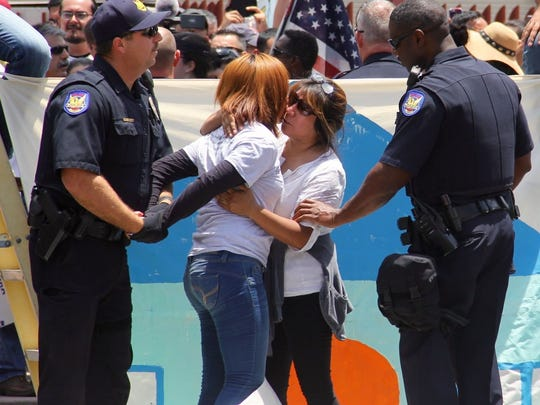Berta Najera (right) hugs her daughter Viridiana Hernandez as they are being arrested during a civil disobedience act at ICE in Phoenix to call on an end to deportations.
