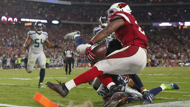 Arizona Cardinals running back David Johnson (31) is tackled short of the end zone against the Seattle Seahawks in overtime at University of Phoenix Stadium in Glendale, Ariz. October 23, 2016.