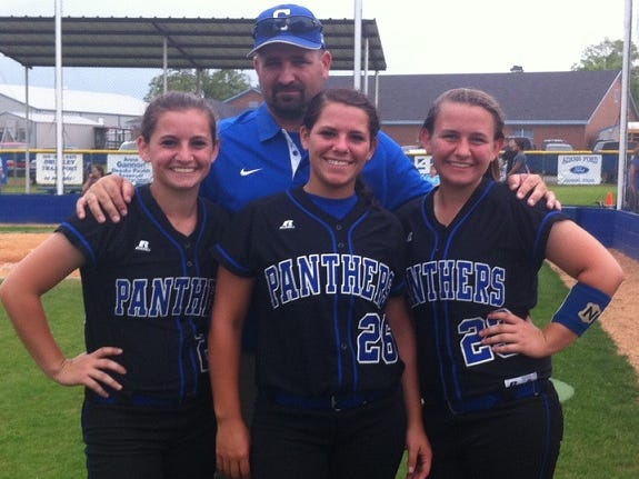 Alyssa, Emily and Shorty Welborn of Stanley pose with their father, David, following a game this season. The sisters will lead Stanley into the Class B state playoffs this weekend.