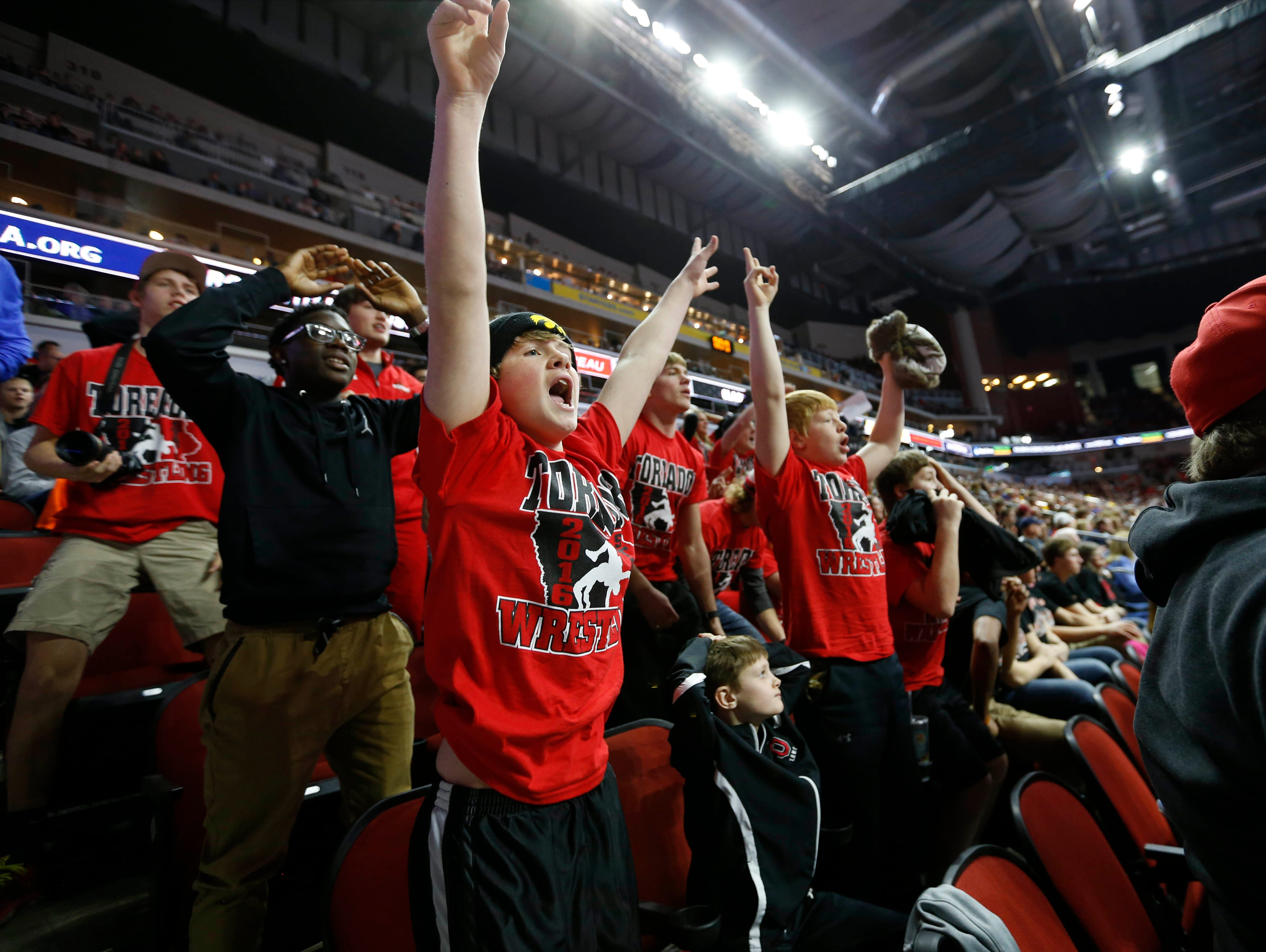 Nick Breon, 14 (left) and a group of fans from Boone cheer as they watch Boone freshman Mason Hulse get the win Thursday, Feb. 18, 2016 in the class 3A opening round of the state wrestling tournament in Des Moines.