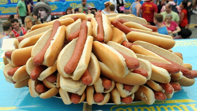 Hot dogs and other processed meats have been linked to carcinogens. This photo shows the lineup at Nathan's hot dog contest in Coney Island.