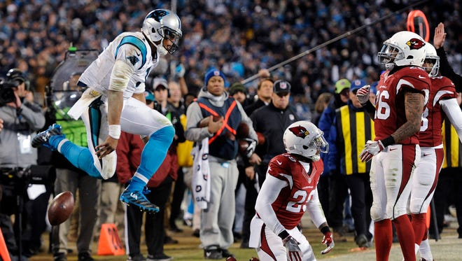 Carolina Panthers' Cam Newton celebrates a first down run during the second half the NFL football NFC Championship game against the Arizona Cardinals on Sunday in Charlotte, N.C.