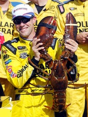 NASCAR driver Matt Kenseth poses with a lobster after