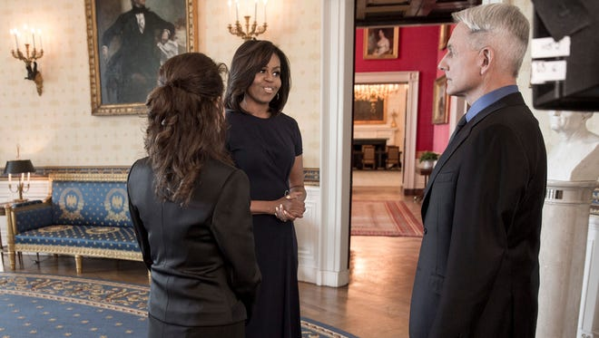 First Lady Michelle Obama, center, will appear with Reiko Aylesworth, left, and Mark Harmon on the May 3 episode of CBS drama 'NCIS.'