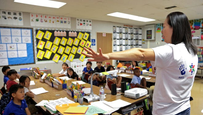 Teacher Regina Yang leads a bilingual Korean-English language immersion classes at Porter Ranch Community School in Los Angeles.