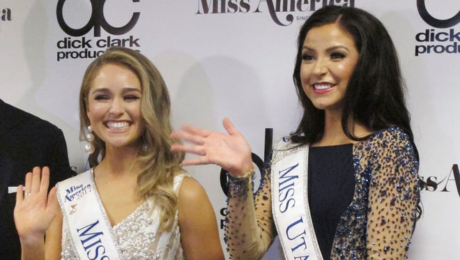Miss Texas Margana Wood, left, and Miss Utah JessiKate Riley, right, meet the media after winning the first night of preliminary competition.
