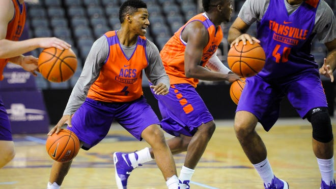 University of Evansville's Jaiveon Eaves (4) runs drills with teammates during practice at the Ford Center in Evansville, Wednesday, Nov. 9, 2016.