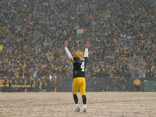Green Bay Packers quarterback Brett Favre celebrates after a touchdown during the Jan. 12, 2008, playoff game against the Seattle Seahawks. File/USA TODAY NETWORK-Wisconsin