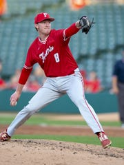 Fishers High School senior Luke Albright (8) delivers a pitch during the 52nd Annual IHSAA Baseball State Finals Class 4A game, Friday, June 15, 2018, at Victory Field in Indianapolis. Fishers won 4-3.