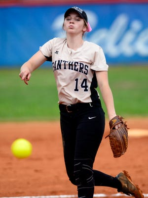 Milton High School pitcher Megan Robertson lets the ball go Thursday in a 1-6A semifinal against Escambia High School.