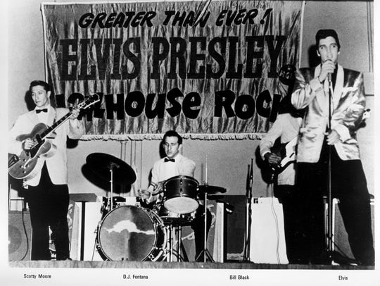 A early publicity photo of Elvis Presley with Scotty