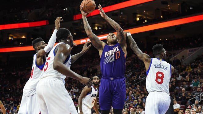 Phoenix Suns forward P.J. Tucker (17) shoots during the second quarter against the 76ers on Friday at the Wells Fargo Center.