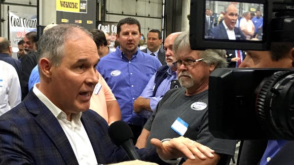 EPA Administrator Scott Pruitt, talks to a reporter after speaking at Whayne Supply in Hazard, Ky, Monday, Oct. 9, 2017.  Pruitt says the Trump administration will abandon the Obama-era clean power plan aimed at reducing global warming. (AP Photo/Adam Beam)