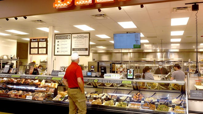 A customer shops the deli Wednesday at EatWell, a natural food store by Schnucks located at the site of the former Lucky's Market at 111 S. Providence Road. The 42,000-square-foot store will focus on health, wellness and natural foods.