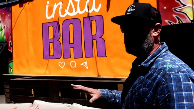 Scott Millette has created Instabar in Hampton, an outside bar with changing backgrounds that people can take selfies with to have fun and listen to live music.
