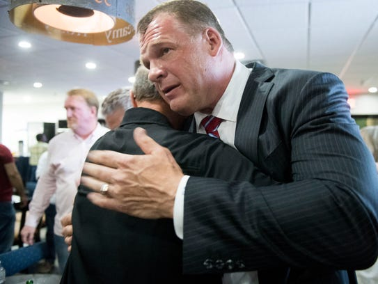 Glenn Jacobs is congratulated by supporters on Tuesday,