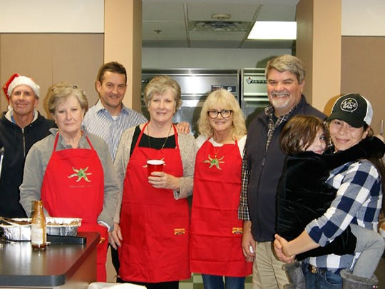 Members of Fernvale Community Church provide and serve