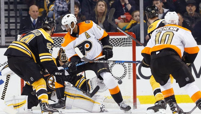 The Flyers' Wayne Simmonds, screens Boston Bruins' Tuukka Rask on a goal by the Flyers' Brayden Schenn.