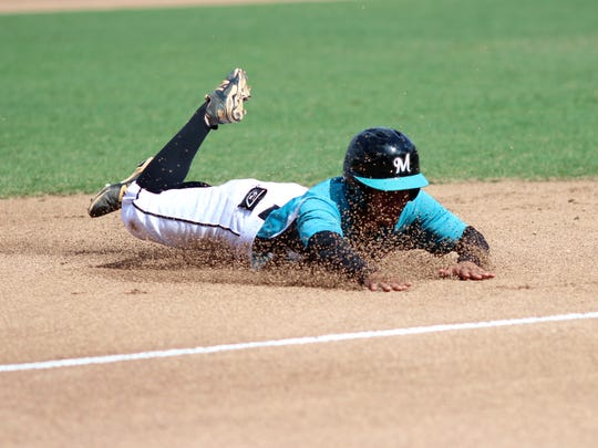 Kobe Lopez slides into third base during Saturday's FHSAA Class 5A State Championship game between Mosley High School and Archbishop McCarthy High School at jetBlue Park in Fort Myers, Florida.