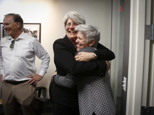 Former University of Iowa senior associate athletic director Jane Meyer, left, and her partner, Tracey Griesbaum, hug after giving a press conference on Thursday, May 4, 2017.  Griesbaum, who was fired as the Iowa women's field hockey coach in 2014, reached a settlement with Iowa on Friday, two weeks after Meyer won a case against the university for $1.43 million