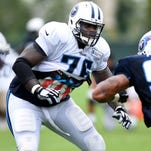 Titans tackle Byron Bell is pleased with his adjustment from tackle to guard.