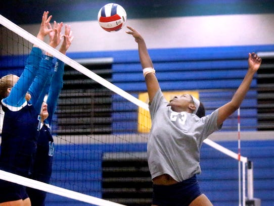 Blackman's Paz Dozie-Nnamah (23) hits the ball over