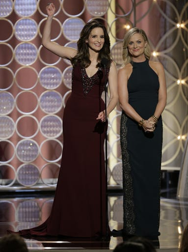 "Hosting for the second year in a row, Tina Fey and Amy Poehler made the star-studded room (and everyone watching at home) laugh at the beginning of the 71st Annual Golden Globe Awards. They poked fun at stars in attendance, including George Clooney: ""'Gravity': The story of how George Clooney would rather float into space and die than spend time with a woman his own age."" Boom."