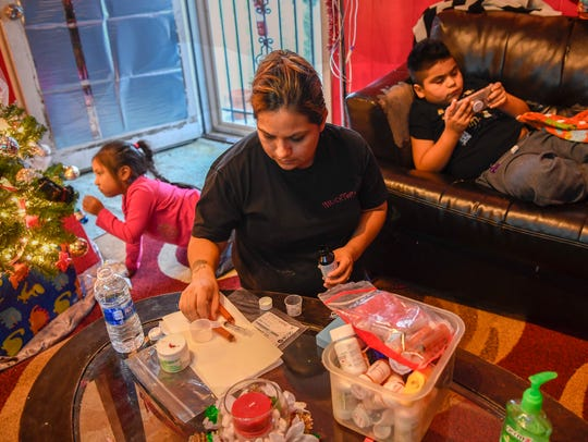 Blanca Carranza-Hernandez sorts out medications for