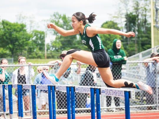 Jen Rotti of St. Johnsbury wins the 300 hurdles during