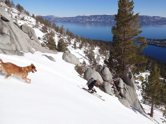 A backcountry skier heads downhill from a peak overlooking Emerald Bay at Lake Tahoe. Some skiers are worried about reduced access to the backcountry in the winter.