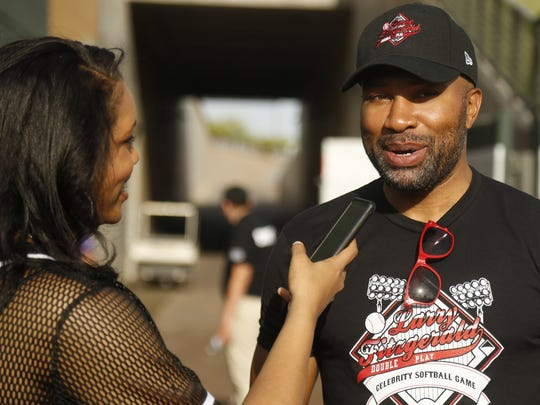 Derek Fisher talks with reporters before the Larry Fitzgerald Celebrity Softball game at Salt River Fields in Scottsdale, Ariz. on April 21, 2018.