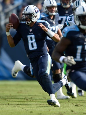 Titans quarterback Marcus Mariota (8) tries to control the football during the second quarter at Nissan Stadium Sunday Nov. 15, 2015, in Nashville, Tenn.