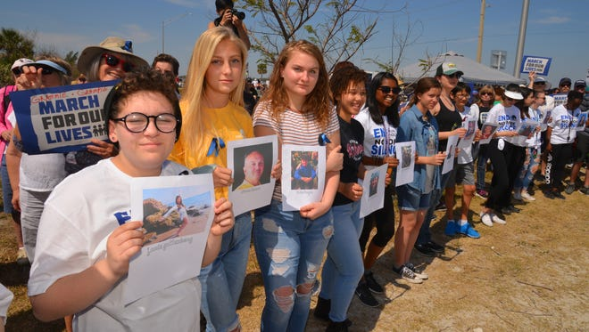Thousands showed up to listen to speakers and peacefully line the Eau Gallie Causeway Saturday during the March for our Lives in Melbourne.