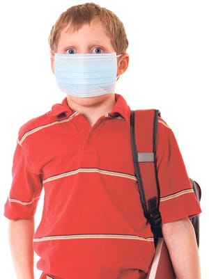 You can take steps to curb those nasty bugs that come home from school. And no, your kid doesn't need a mask!